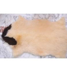 Peau de moutontachetée naturelle